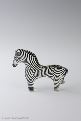 Abraham Palatnik clear and black zebra sculpture.