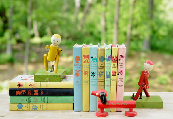 Junior Deluxe Books and Antique Mechanical Toy Bookends