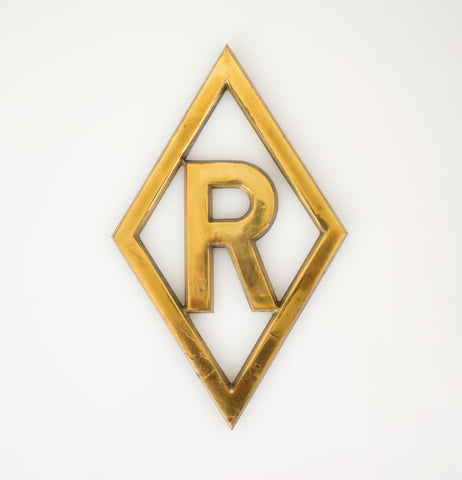 'R' Brass Trivet or Wall Plaque