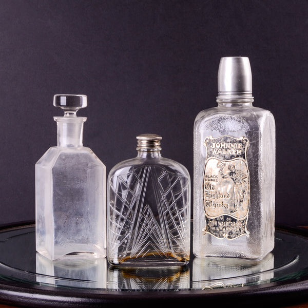 Trio of Vintage Glass Bottles and Flasks
