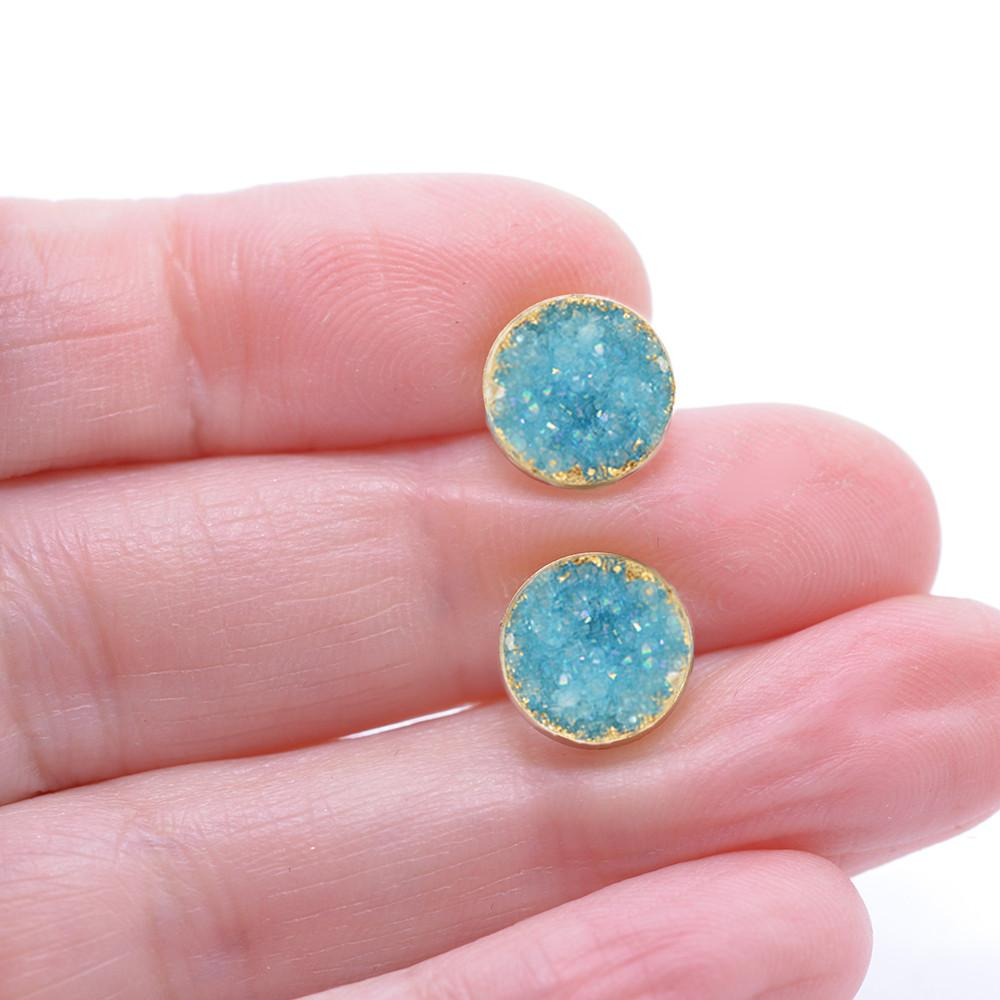 Aqua druzy post earrings in hand