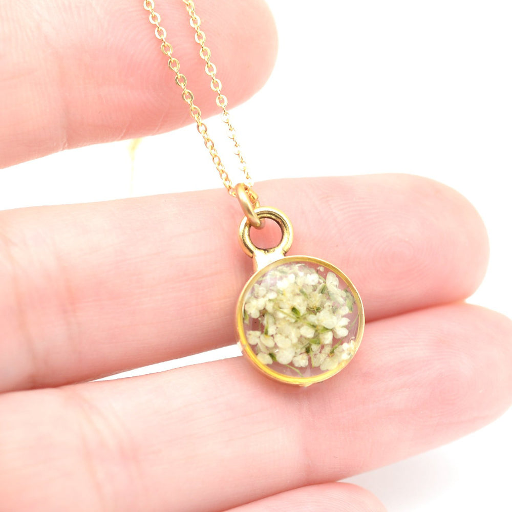 Dainty blossoms gold necklace in hand