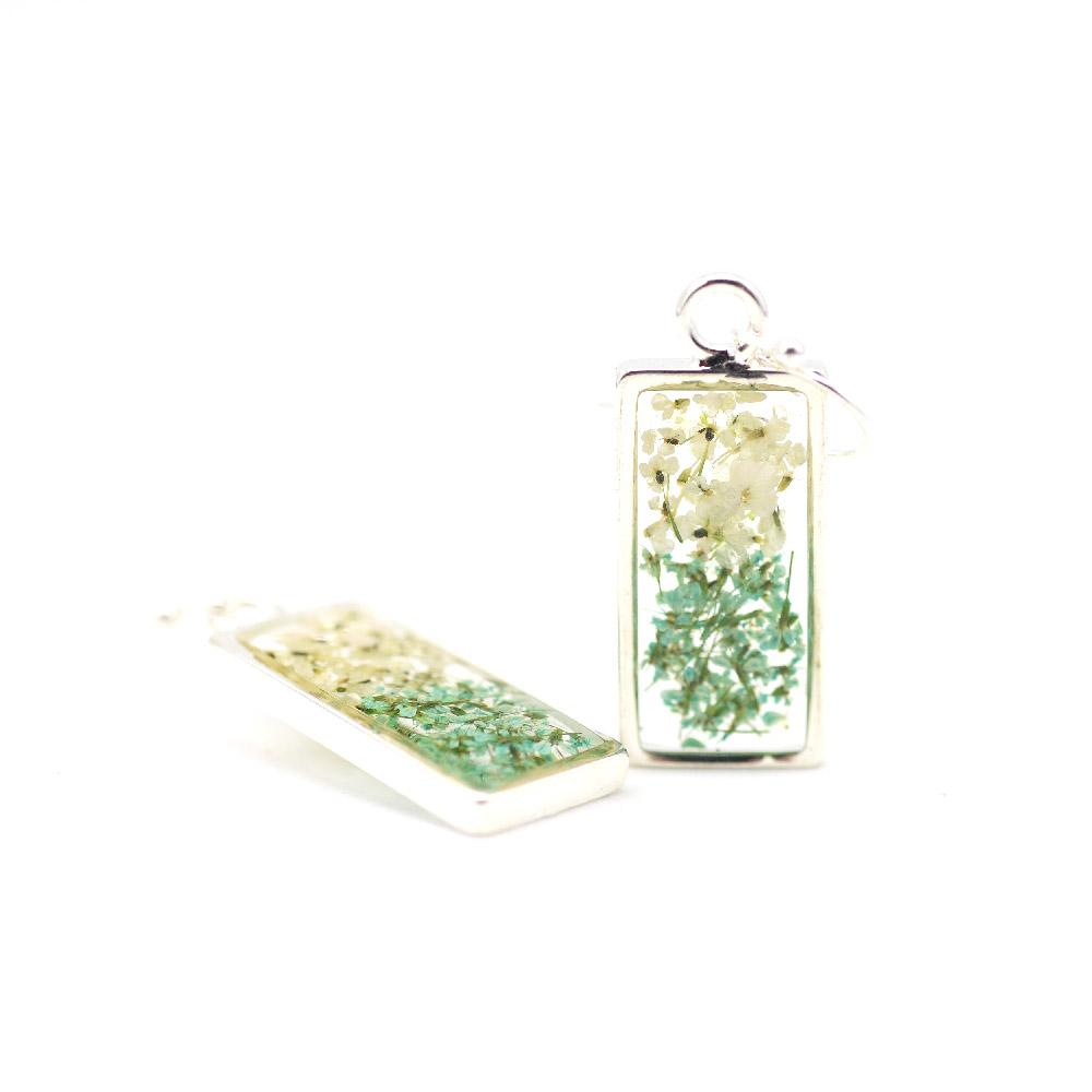 green and white floral earrings