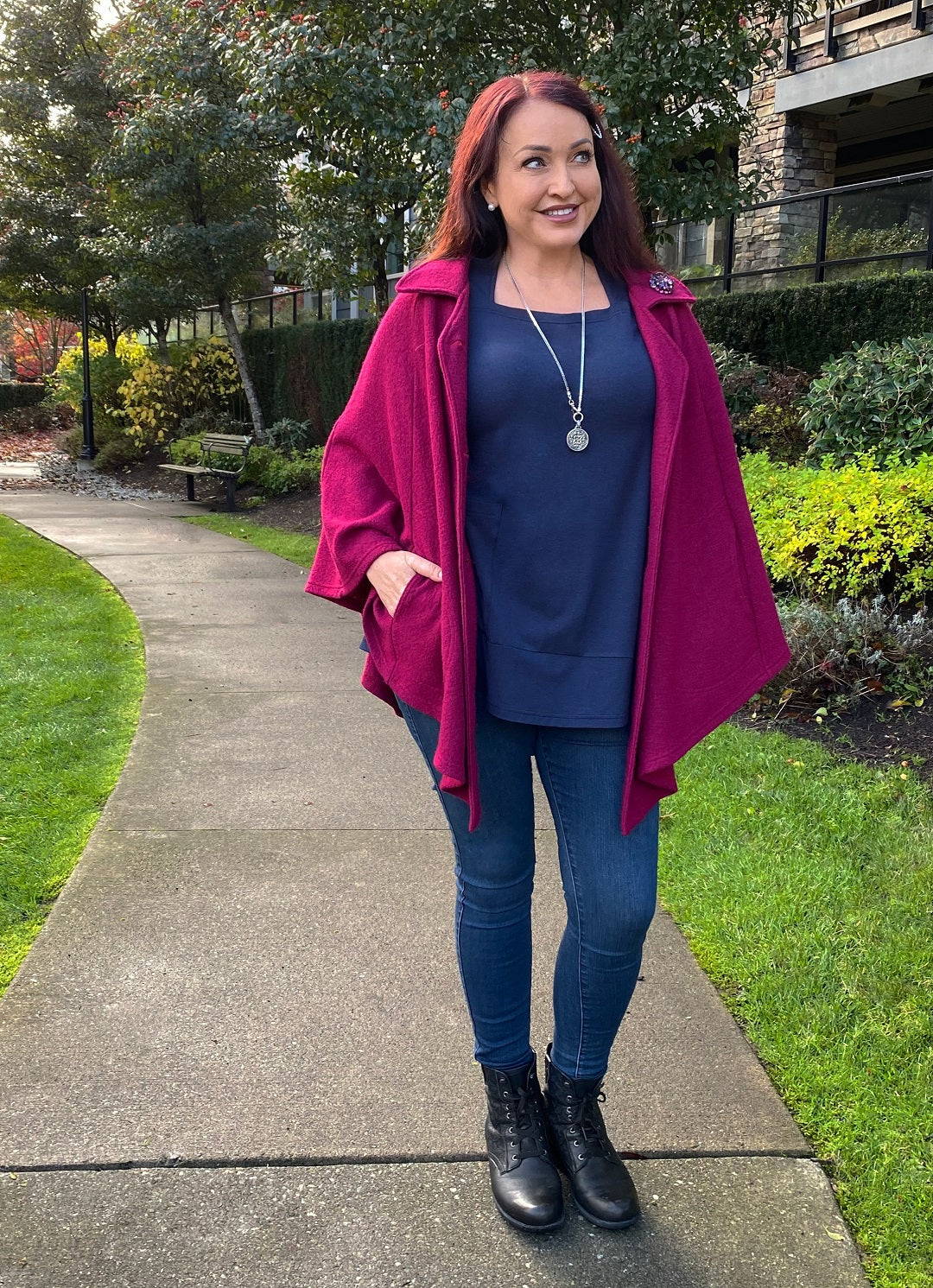 Leah Tuttle wears a Diane Kennedy Cape and Navy Tempo Tunic over jeans