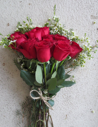 Red Roses in Wrapped Bouquet