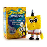 kid robot sponge bob next to box