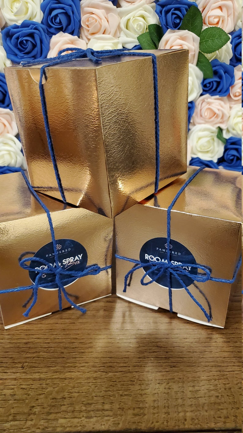 Boxed room spray packaging in gold and blue