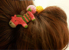 Hand knitted pink horse ponytail holder