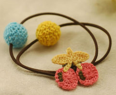 Hand knitted cherry ponytail holder