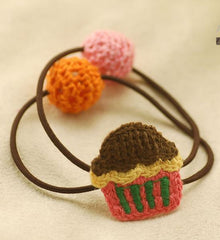 Hand knit cupcake ponytail holder in brown