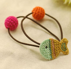 Hand knitted fish ponytail holder in green and yellow