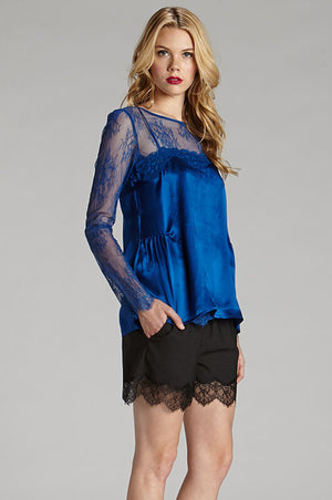 Model is wearing the CC Silk Lace Cami in sapphire with the All Over Lace Top in sapphire and the Marilyn Lace Silk Shorts in black.