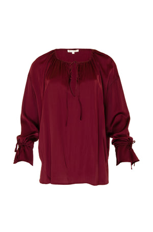 The Pleasant Wrap Front Tie Top in burgundy.