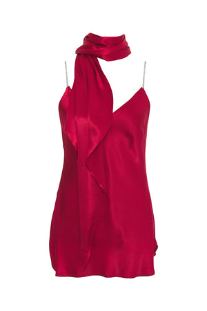 The Aimee Camisole in fiery red, with matching sash used as a scarf.