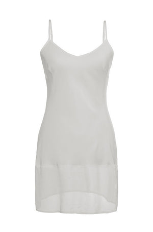 The Sheer Edge Silk Tunic in white.