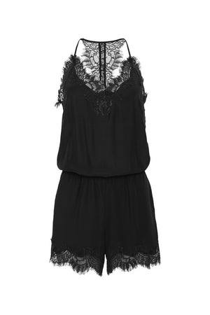 The Coco Lace Romper in black.