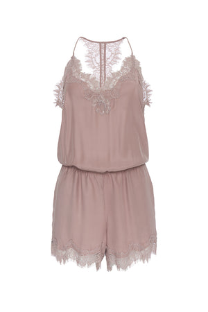 The Coco Lace Romper in muted rose.