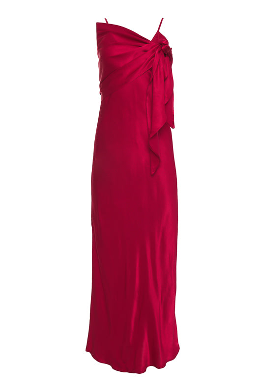The Hayley Long Slip Dress in Fiery Red with matching sash worn across the bust and tied under the shoulder.