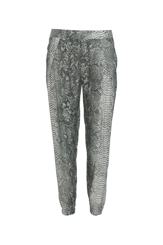 Model is wearing the Python Print Pant in grey python with the Zoe Coco Cami in black and black sneakers.
