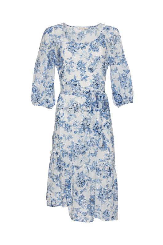 Model is wearing the Provence Peasant Dress in navy provence toile with baby blue, open toe, slip in, flat sandals.