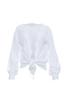 The Silk Wrap Top in bright white; shown tied at the front waist.