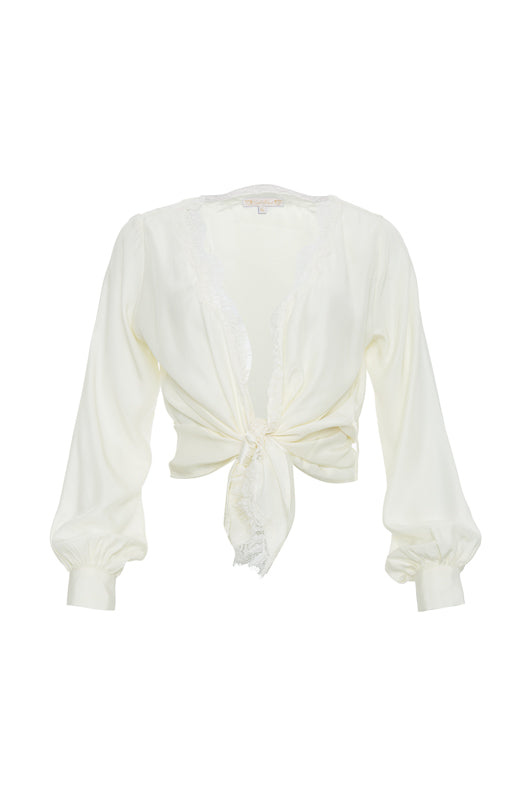 The Silk Wrap Top in dove; shown tied at the front waist.