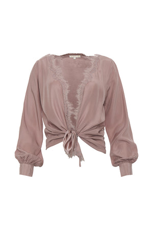 The Silk Wrap Top in muted rose; shown tied at the front waist.
