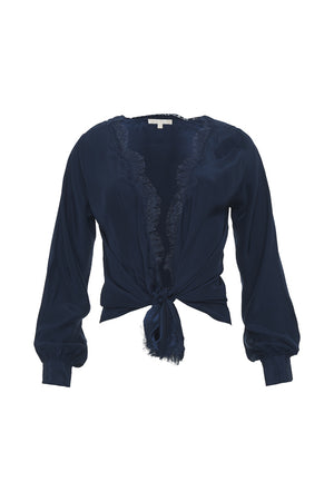 The Silk Wrap Top in navy; shown tied at the front waist.