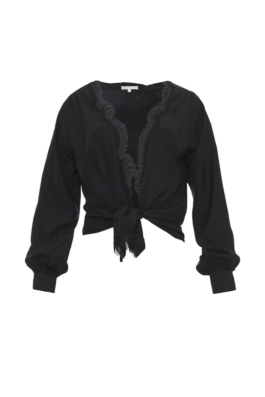 The Silk Wrap Top in black; shown tied at the front waist.