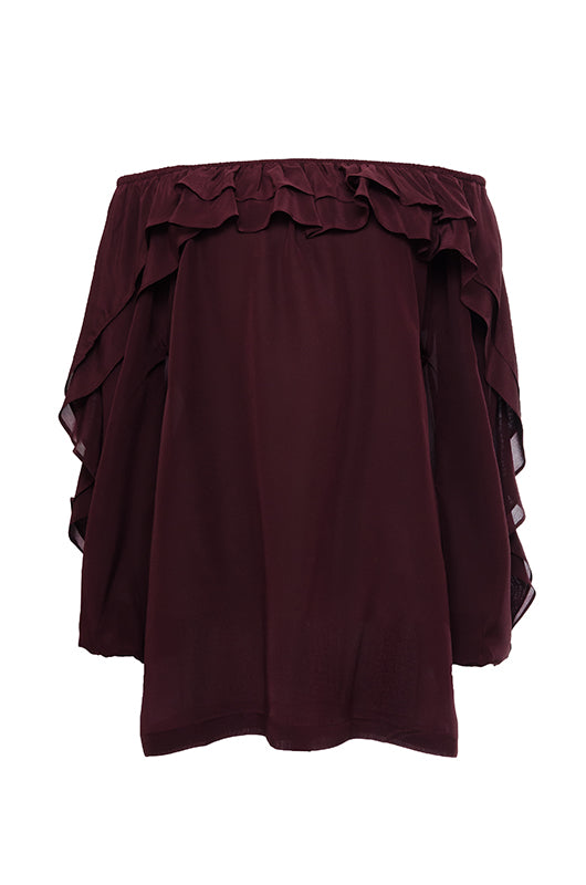 The Double Ruffle Silk Top in burgundy.