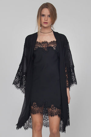 Model is wearing the Coco Lace Silk Kimono in black, opened, with the Coco Lace Silk Tunic in black underneath.