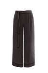 The Wide Leg Silk Pants in pewter with black piping.