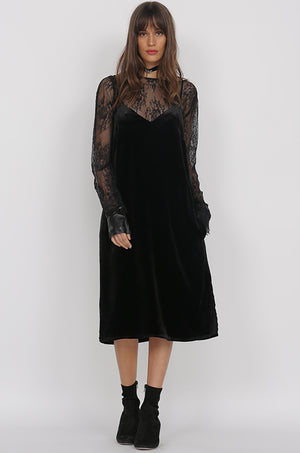 Model is wearing the Susan Velvet Self-Tie Dress in black with the All Over Lace Top in black underneath. Also worn with black high heel boots.