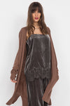 Model is wearing the Anastasia Lace Velvet Cami in pewter with the Anastasia Lace Velvet Pants in pewter and with a brown, knee length open cardigan.