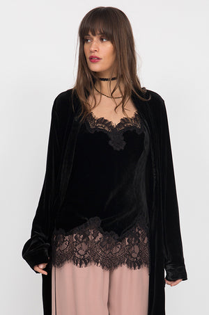 Model is wearing the Anastasia Lace Trim Velvet Cami in black with the Anastasia Lace Velvet Robe in black and the Tencel Wide Leg Cargo Pant in muted rose.