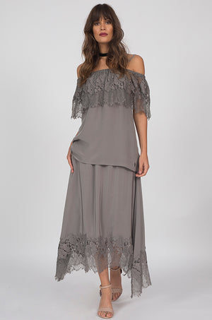 Model is wearing the Julia Silk Lace Skirt in steeple grey with the Julia Lace Silk Off The Shoulder Top in steeple grey.