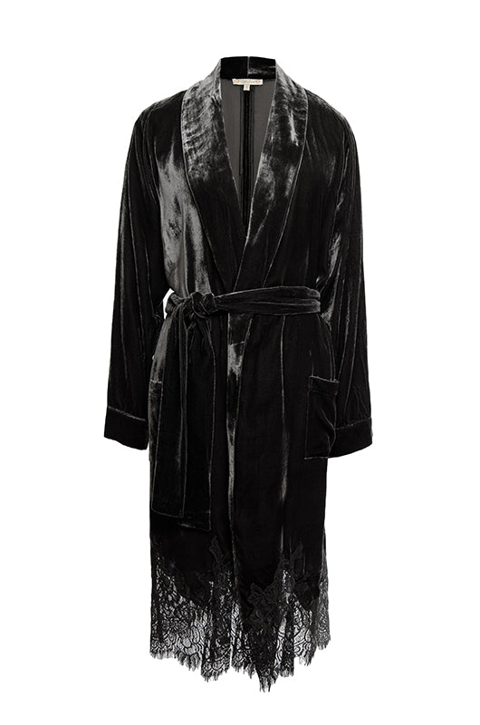 Model is wearing the Anastasia Lace Velvet Robe in black with the Coco Lace Velvet Dress in black and black high heel boots.