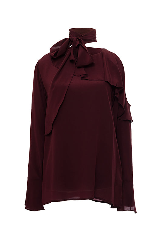 The Silk Ruffle Cold-Shoulder Top in burgundy.