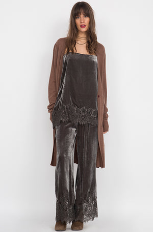 Model is wearing the Anastasia Lace Velvet Pant in pewter with the Anastasia Lace Velvet Cami in pewter and with a brown, knee length open cardigan.