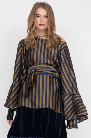 Model is wearing the Stripe Silk Batwing Top with matching sash used as belt, on top of the Anastasia Lace Velvet Dress in navy.