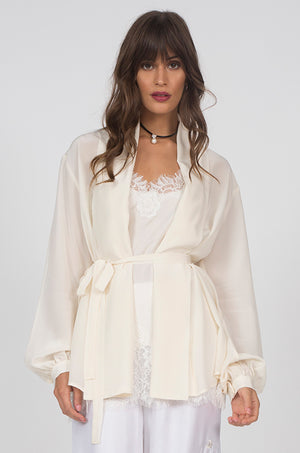 Model is wearing the Silk Crepe Jacket in dove with the Coco Lace Silk Cami in white underneath and the Emily Silk Embroidered Pants in white.