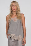 Model is wearing the Coco Lace Silk Straight Cami in steeple grey with birch lace. Also worn with the Hammered Silk Belted Pants in steeple grey.