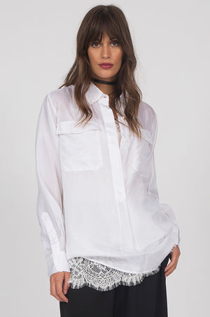Model is wearing the Habotai Pullover Silk Shirt in white with the Coco Lace Silk Straight Cami in white.