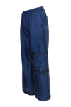 The Emily Silk Embroidered Pants in navy with black embroidery; side view.