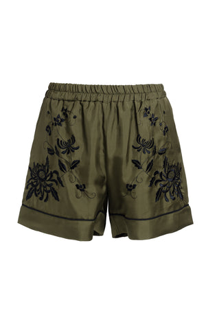 The Emily Embroidered Silk Shorts in olive with black embroidery.