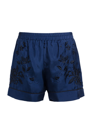 The Emily Embroidered Silk Shorts in navy with black embroidery.