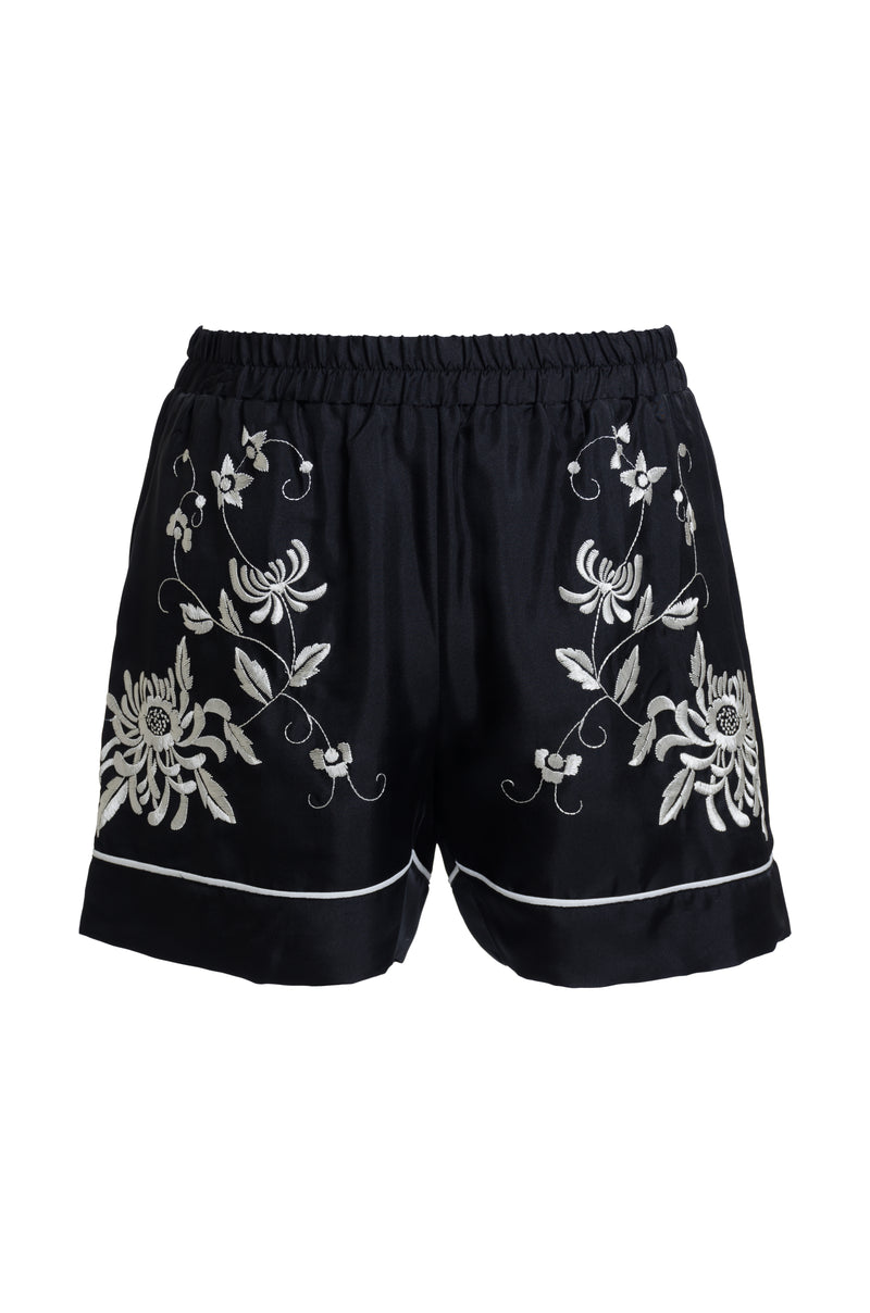 The Emily Embroidered Silk Shorts in black with white embroidery.