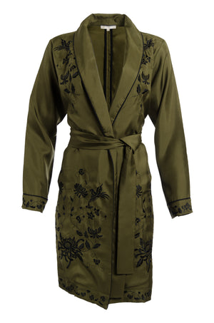 The Emily Embroidered Silk Duster in olive with black embroidery.