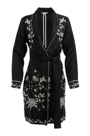 The Emily Embroidered Silk Duster in black with white embroidery.