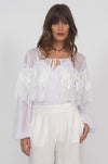 Model is wearing the Julia Lace Ruffle Silk Top in white with the Floral Lace Silk Cami in white underneath and the Wide Leg Linen Belted Pants in white.